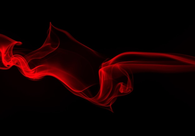 Red smoke abstract on black background, darkness concept