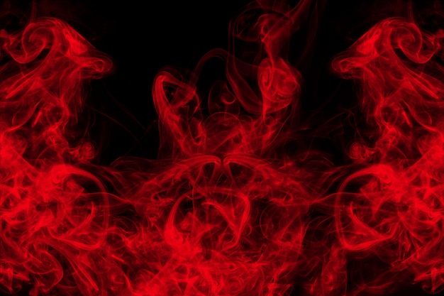 Red smoke abstract on black background, fire design and darkness concept