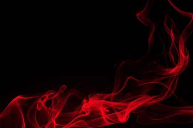 Red smoke on black background. fire design