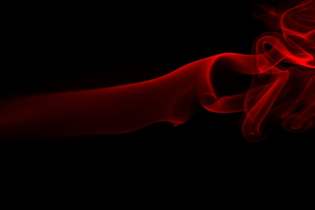 Red smoke on black background, fire