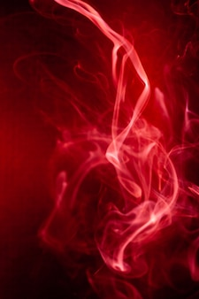 Red smoke motion on black background.
