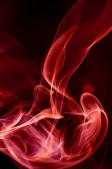 Red smoke motion on black background.