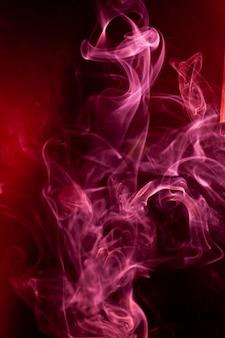Red smoke motion on black.