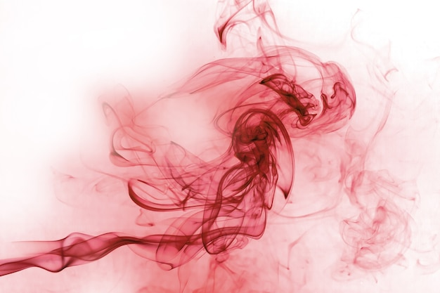 Red smoke motion on white surface.