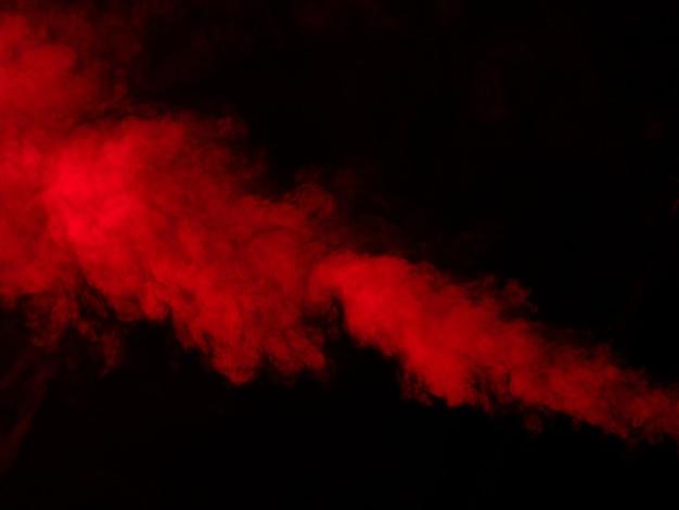 黒の背景に赤い煙、テクスチャ