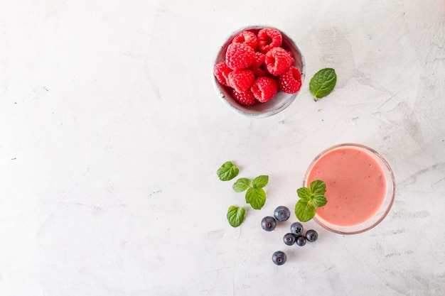 Red smoothie with raspberries and basil