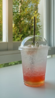 Red soda on table