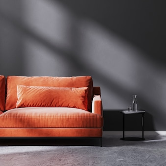 Red sofa with black coffee table in empty room with black empty wall with sun rays, black empty wall, 3d rendering