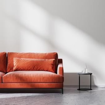 태양 광선이 있는 흰색 빈 벽, 원시 콘크리트 바닥, 스칸디나비아 미니멀리즘 스타일, 3d 렌더링이 있는 빈 방에 검은색 커피 테이블이 있는 빨간색 소파