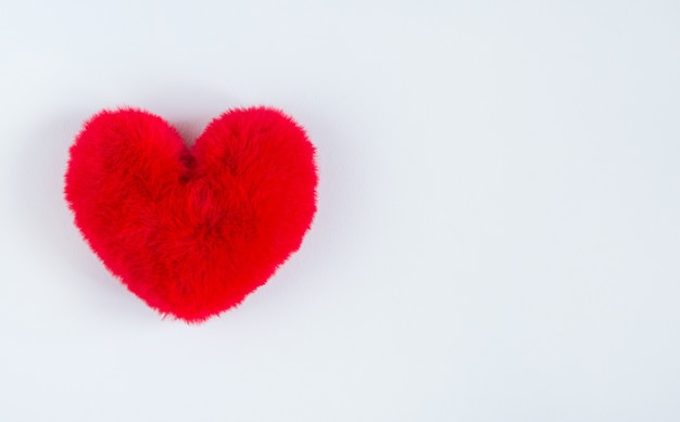 Red soft heart on soft white background. a symbol of a healthy person. valentine's day
