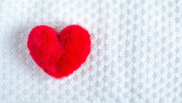 Red soft heart on soft white fabric. a symbol of a healthy person. valentine's day