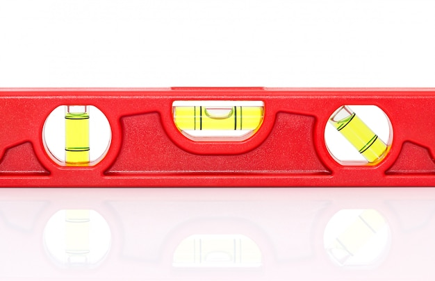 Red spirit level with shadow