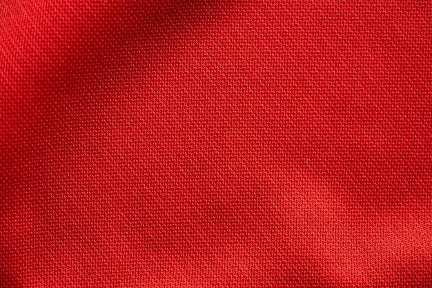 赤いスポーツ服生地サッカージャージーの質感をクローズアップ