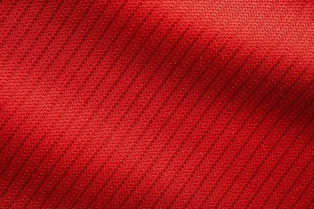 Красная спортивная одежда ткань футбольного трикотажа текстуры крупным планом