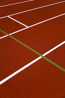 Red stadium running track closeup