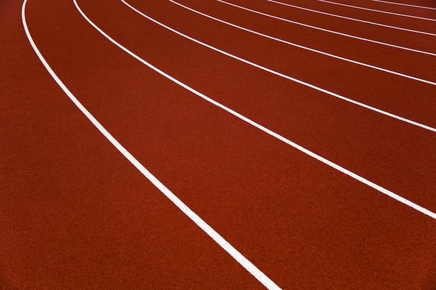 Red stadium running tracks closeup