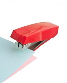 Red stapler isolated on white background
