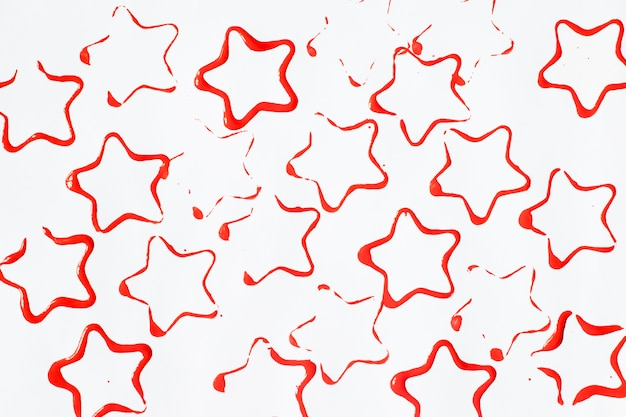 Red star-shaped stains