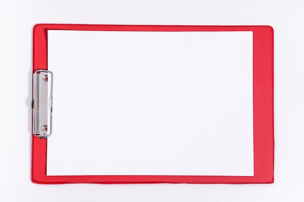 Red stationery tablet with paper. the office empty notepad page. mock up of the tablet. copy space.