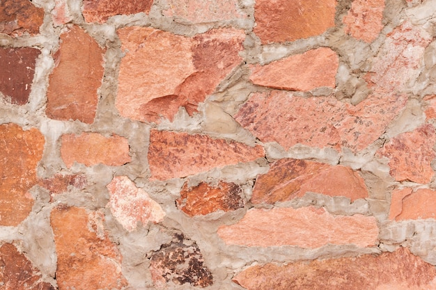 Red stone wall outdoor background and texture of decorative slate stone