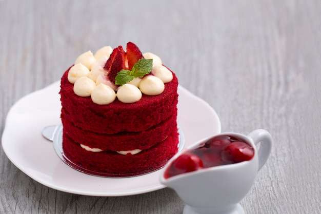 Red strawberry cake with white chocolate on wood.copy space.