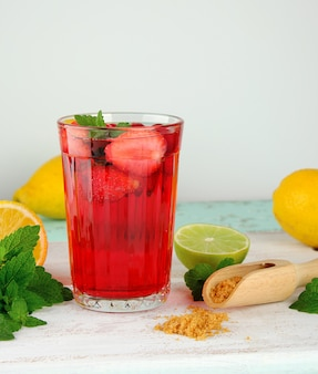 Red strawberry lemonade in a glass