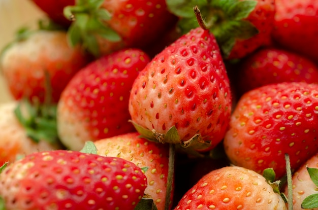 Red strawberry with a patterned background blurred