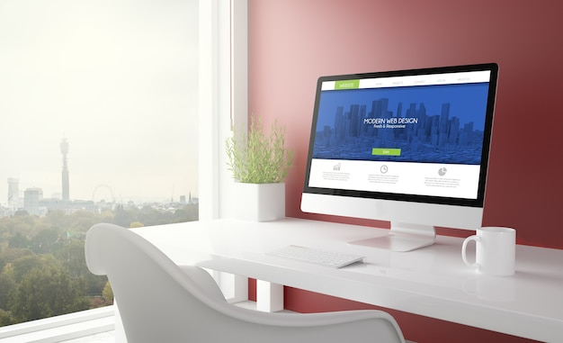 Red studio with modern web design computer with london skyline in the background