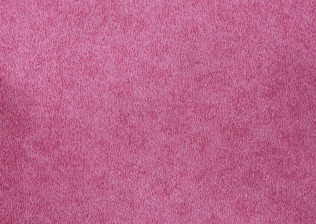 Red suede texture background of natural skin leather. underside of animal cow skin texture background