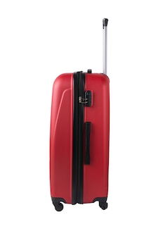 Red suitcase isolated. travel concept