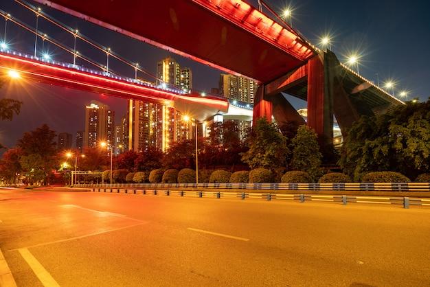 Red suspension bridges and highways at night