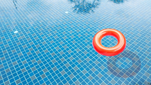 Red swim ring in the swimming pool.