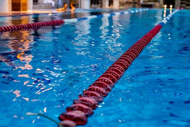 Red swimming lane marker in swimming pool.