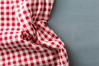 Red table cloth on gray background