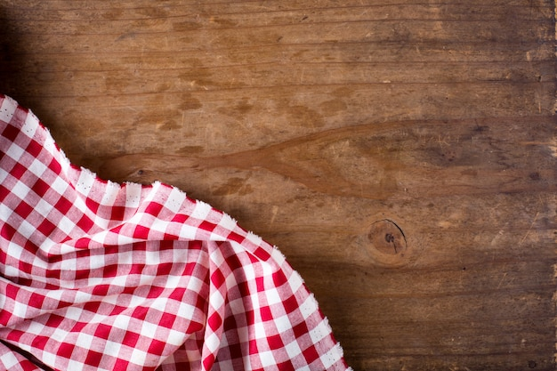Red table cloth on wooden table