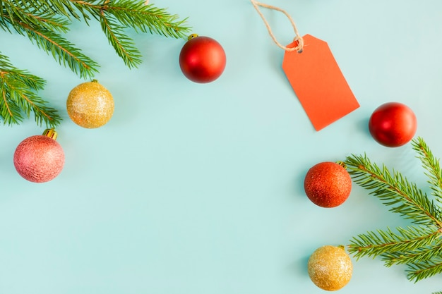 Red tag and christmas decorations on a blue background.
