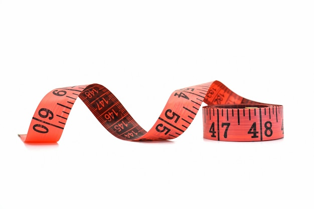 Red tape measure isolated on white background.