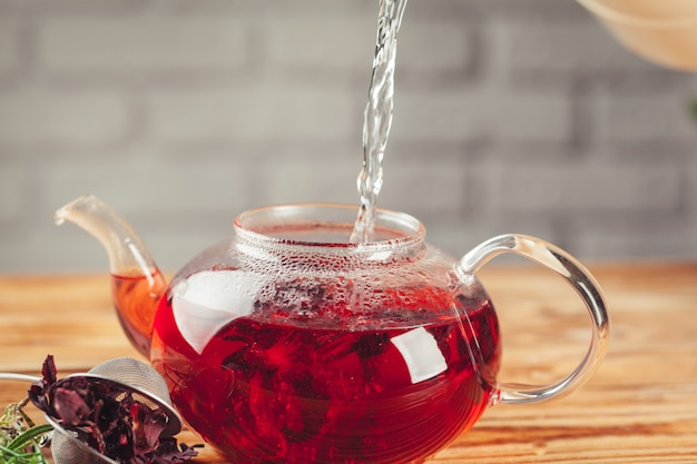 Red tea on a wooden table