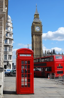 Red telephone box with big ben on a sunny day