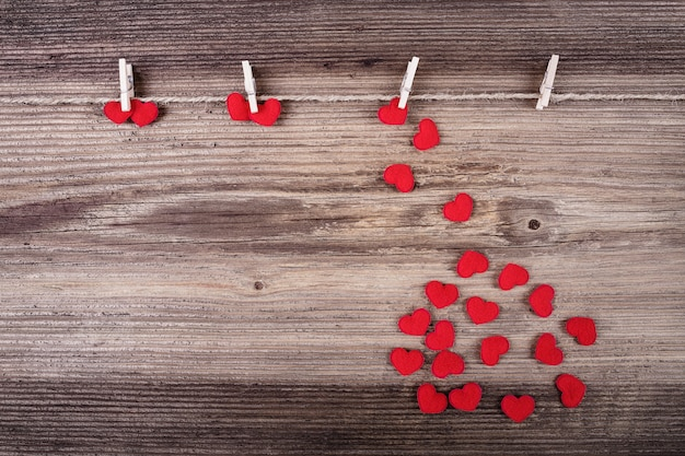 Red textile hearts on wooden. love concept.
