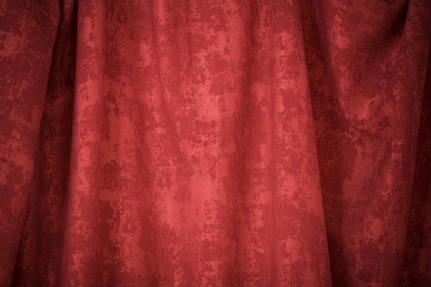 Red textured curtain background close up
