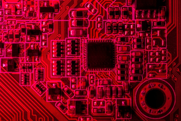 Red themed circuit board with chip close-up