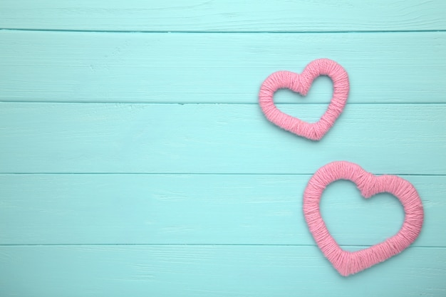 Red thread heart on blue background
