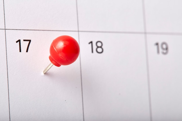Red thumbtack tax day