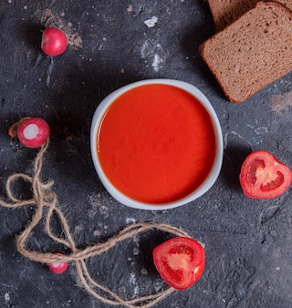 Red tomato soup in a white bowl