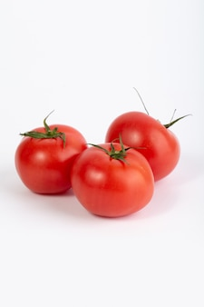 Red tomatoes fresh ripe mellow on white background
