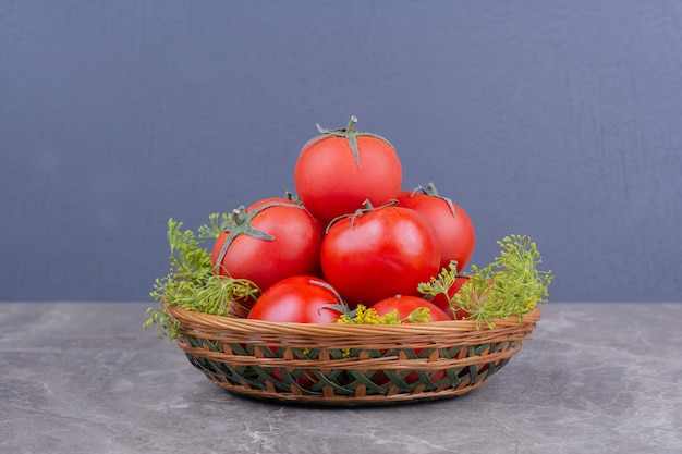 Red tomatoes isolated in a wooden plate