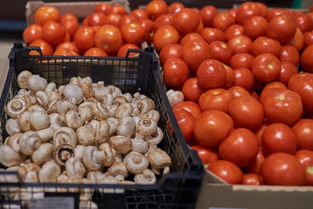 Red tomatoes and mushrooms in the store