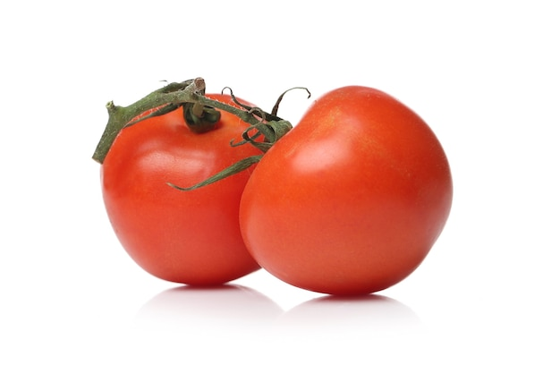 Red tomatoes on a white surface