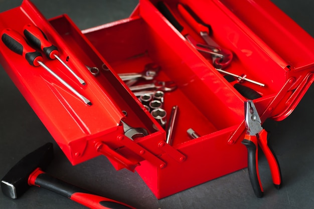 Red toolbox with metal wrench kit for repair